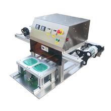供应全自动餐盒封口机封膜机羊肉卷梅菜扣肉商用包装机图片